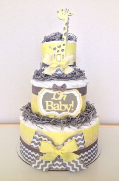 Neutral Chevron Yellow and Gray Giraffe Diaper Cake Baby Shower Centerpiece by PoshPartyCompany on Etsy https://www.etsy.com/listing/200342638/neutral-chevron-yellow-and-gray-giraffe