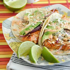 Seared Salmon Tacos with honey-lime slaw and creamy sriracha ranch!  My mouth just watered.  Yumm