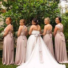 Beautiful back shots of bride @christy_haddrick_ & her bridesmaids in their Goddess By Nature signature ballgown in a  blush pearl colour !