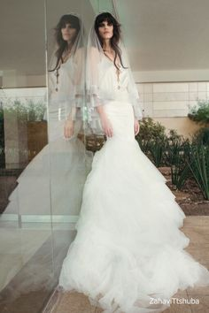 Destination Style - Dramatic Entrances with Zahavit Tshuba  Anna  Ivory gown. A two piece halter scallop shapeed bodysuit and mermaid silk and soft tull skirt, chantily lace trim detailing on skirt, mermaid cut.  http://theantibridezilla.com/post/121974339537/photoset_iframe/theantibridezilla/tumblr_nq86yaO17b1rmrycv/500/false