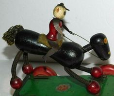 It is a wooden and wood beaded, black race horse and jockey. The jockey has cutout tin arms and legs. Pull Toy, Vintage Antiques, Ted, Horses, Christmas Ornaments, Holiday Decor, Ebay, Home Decor, Decoration Home