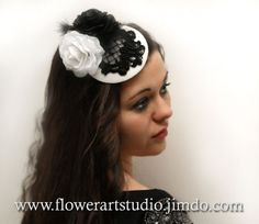 Unique handmade small white hat with black and white silk roses ,black embroidered lace and black feathers.  This amazing couture fascinator with
