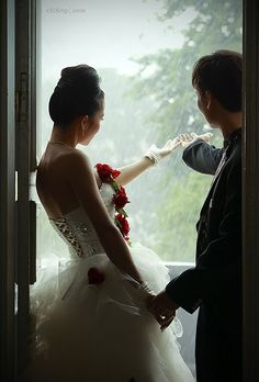 indoors backlit with rain coming down. moody and romantic