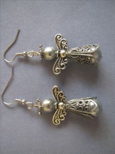 Christmas angel earrings antiqued silver and silver glass pearls. by Unlost and Found Jewelry on facebook.com