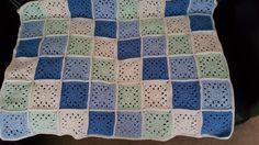 Granny square cot blanket