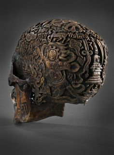 300 year-old carved Tibetan skull, on this side we see Vajrapani & a Chorten or Stupa on the back