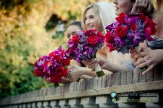 Red and purple wedding flowers, love this for the bridesmaids