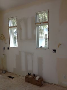 Stove wall with new windows, rebuilt and plastered