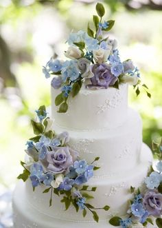 I love the idea of flowers, especially hydrangeas on a wedding cake, because they are known for being such pretty colors and changing colors. AH in love.