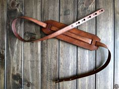 This leather guitar strap is handcrafted using rugged 6-7oz cowhide. The simple two-piece design has keyholes notched into each end, it is