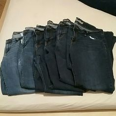 Lot of 6 Old Navy Sweetheart Jeans Lot of 6 Old Navy Sweetheart jeans. 14 short. Boot cut. Both light and dark wash. Light wash jeans have been worn a handful of times, and dark wash jeans have been worn a couple of times. Slight discoloration at the crotch of two of the dark wash jeans. No pilling, holes, or tearing in any pair. Old Navy Jeans Boot Cut