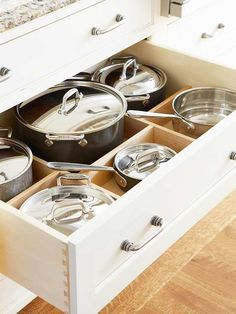 Kitchen cabinet for storage of pots and pans. Nice organization for what would normally create a pile of pans in your cabinets. From Better Homes & Gardens