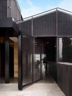 The mesh door of the Salix Bistro In Victoria's Mornington Peninsula, Australia | http://www.yatzer.com/Willow-Creek-Vineyard-bistro