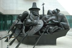 Large bronze sculpture of Haida canoe with human, mythic and animal passengers  by Bill Reid