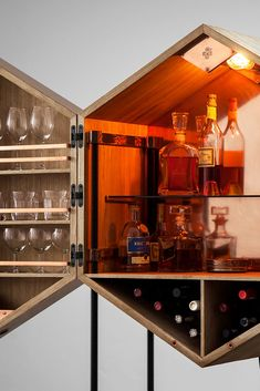 The unusual and mesmerizing interior of the luxury mini bar cabinet - pure copper, natural oak wood, smoked glass, in-built light and a lot of space for the finest alcohol collection.