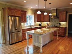 kitchen. white oak floor. island. cabinets.