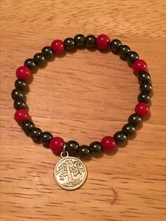 Hand made, bamboo coral and hematite with a tree of life charm