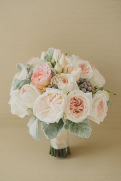 pale pink garden rose bouquet with silver brunia and dusty miler