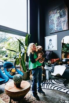 """House tour: inside Abigail Ahern's eclectic East London terrace: Abigail Ahern isn't afraid of embracing her dark side. Although the British interior, furniture and accessories designer once revelled in a pale Scandi palette, there is no remaining evidence of this in the four-storey 1860s East London terrace house she shares with her husband, Graham Scott. """"I'd grown bored with white walls,"""" she says. """"So one day I experimented with painting a dark colour in a small alcove. I was amazed..."""
