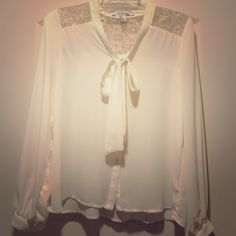 Forever21 Cream Blouse with Gold Metallic Lace Only worn once. Sheer cream blouse with front tie and gold lace design. Perfect for professional wear or a fashionable addition to your closet. Purchased at Forever21. Forever 21 Tops Blouses