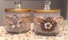 Re-cycled bath and body works candle jars. Add a glass or decorative knob to top and embellish jars. Use for cotton balls, bath salts or whatever you want. These were a quick and inexpensive craft, makes a nice gift.