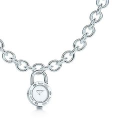 Tiffany 1837™ watch lock charm in stainless steel on a silver necklace.