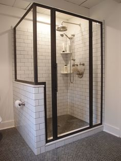 Custom blackened stainless steel shower enclosure