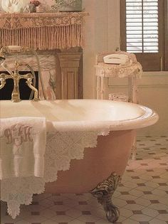 Romantic vintage bathroom with pink tub. Lovely, minus the modern telephone.
