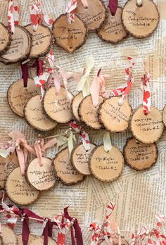 Hand-written wood rounds make for super-festive escort cards. Hang them from bright red and green ribbon for a hint of holiday cheer.
