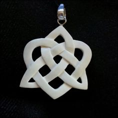 BP-06 Celtic Heart and Trifecta  This piece is hand carved from bone and antiqued using an ancient aging process utilizing coffee and tea.  Dimensions: 1.75h x 1.5w - Contact Tri De Dana for Pricing Details: info@tridedana.com