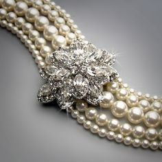 Antique Broach + Swap Meet Pearl Strands= The Perfect Bracelet!  Or choker