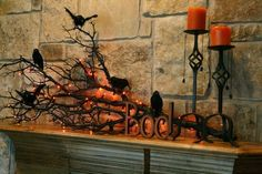 Halloween decoration ideas ! Great idea to bring a branch in from outdoors, spray paint it black and wire crows onto the branch. Wrap with orange lights and there you go! This decoration will be great on any shelf, or window sill, not just a fireplace mantle.