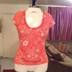 """Ann Taylor Top Ann Taylor Top is made of 60% Cotton and 40% Modal. Beautiful and vibrant, This Top has the colors Orange and White. Looks and fits great. Size Small Petite. Laying flat """"14.5. Length """"21. This item is in Good condition, Authentic and from a Smoke And Pet free home. All Offers through the offer button ONLY. I Will not negotiate Price in the comment section. Thank You Ann Taylor Tops"""