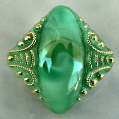 Medium modified square green w/lacy gold vintage moonglow glass button.