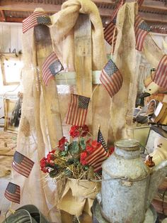 Old Milk Can...flags and red geranium.