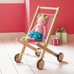 Wish I had known about this cute wooden doll stroller back when I was in the market for one. The one we have is fine (and cheap) but this wooden one just thrills me...