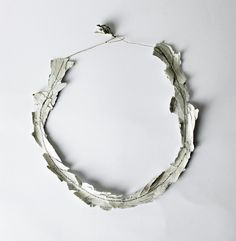 Naama Levit, Untitled, Necklace, 2013         Toilet paper, aluminum foil, acrylic glue, synthetic thread. Pressing, sewing. 70X18X2 mm    While working intensively with a familiar material new qualities are revealed. And from that point on- the form follows the material.