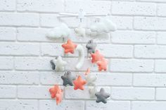 Baby felt mobile pink white grey stars, baby crib mobile, baby musical mobile star Cute children's musical mobile of felt with pearls Composition: 100% eco-polyester.  Hypoallergenic material.  Equipment: Cross with toys: Cloud - 4 pcs, moon - 1 pc., Stars - 18 pcs.