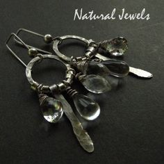Silver handmade earrings with briolettes of Rockcrystal.