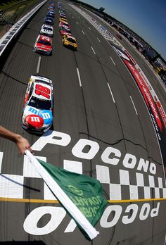 Kyle Busch, driver of the #18 M&M's Red, White, & Blue Toyota, leads the field to the green flag to start the Monster Energy NASCAR Cup Series Axalta presents the Pocono 400 at Pocono Raceway on June 11, 2017 in Long Pond, Pennsylvania.