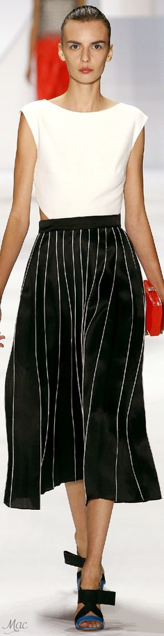 Spring 2016 Ready-to-Wear Monique Lhuillier: I often wear no-iron white, blue, or black short sleeves shirts with long flowing skirts. Skirt length can vary from mid calf to just above knee. I have good calves.