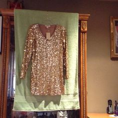MK dress Time to party nice long sleeve gold sequin dress. Xmas special! Markdown until 12/26...❤❤❤❤❤ Michael Kors Dresses Long Sleeve