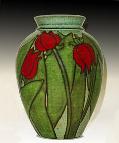 artist_Susan Altenau_NOUVEAU TULIPS_This image is on the home page at the pottery shop I use to work at.  I love this on the black clay body.  I have been doing this tulip for years and discovered the magic that happens of the black clay body.  susanaltenaupottey.com or https://www.etsy.com/shop/SusanAltenauPottery?ref=pr_shop_more
