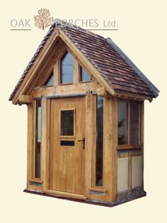 wooden porch with the door at the front and glass sides