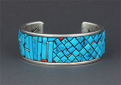 """Sterling silver cuff bracelet inlaid with mosaic turquoise and coral by Eddie Begay (Navajo)  Eddie Begay is from the Ganado area of Northern Arizona. He studied at the Institute of American Indian Arts in Santa Fe, New Mexico from 2003- 2007. He received a judges choice award for his jewelry from the 2009 Prescott Indian Market in Prescott, Arizona. He signs his work """"Eddie Begay.    This bracelet measures approximately 1 inch wide by 5 inches inside circumference.  $660"""