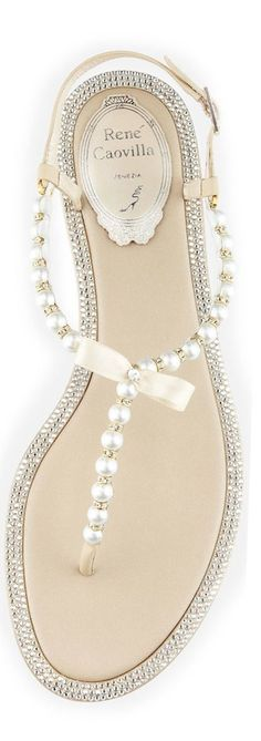 love everything about those rene caovilla. Love the pearls, the bow, the crystals everything.. Perfect beach wedding sandals