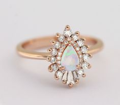 A setting like this for my pear shaped diamond. RhapsodyPetiteOpal.jpg