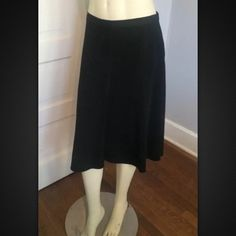 Prada Skirt Black Wool Blend Classic NWT Prada Skirt Black Wool Blend Classic NWT Sz 46 Authentic Mid Calf Length. Made in Italy. Group name: tela crepe stre. Originally sold from halls in Kansas City. Side zip and clasp. This is the perfect black skirt for any occassion or any season. Pet smoke free. Not sure of original price but normally the skirts go for around 600  26 in long 38 in hip 30 in waist Prada Skirts Midi
