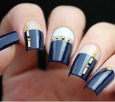 Gorgeous navy + negative space manicure by lovely blogger @nailsandtowel using our Straight Nail Vinyls found at snailvinyls.com