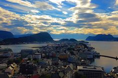 Ålesund - located on the west coast of Norway.  It makes a great stop between Bergen and Trondheim for those travelling Norway over land. . The city was largely destroyed by a fire in 1904 and subsequently rebuilt in the Art Nouveau style of the time which gives the town a unique charm. . Make sure you walk the stairs (or drive up) Aksla - a hill in town which affords the view you see in this photo. . --- Ålesund Norway  --- . . . . . . . . . . . . . . . . #alesund #visitnorway #travel…